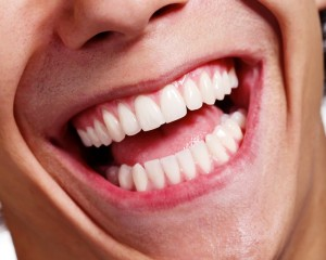 Closeup of mouth, man laughing with beautiful white teeth