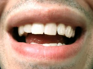 Close up of man's mouth as he talks