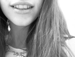 Young woman with chipped tooth