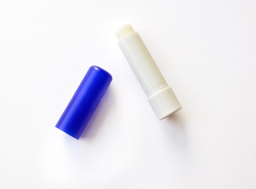 Chaptick lid next to chapstick