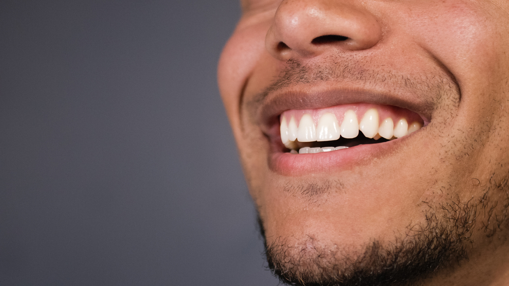 Close up of man's smile healthy teeth