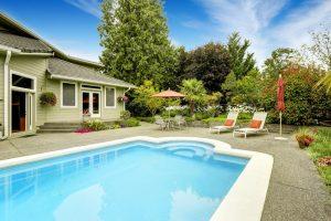 backyard swimming pool and house