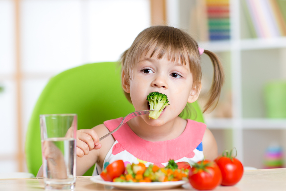 girl eating organic vegetables