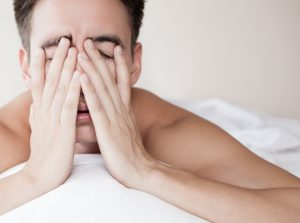 man with OSA showing signs of fatigue as he wakes up