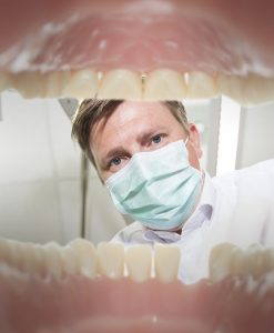 View of a dentist from the inside of mouth, depicting a fear of the dentist