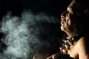 Shaman in Ecuadorian Amazonia during a real Ayahuasca ceremony -- displaying teeth in ancient cultures