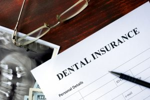 dental insurance documents on a clipboard