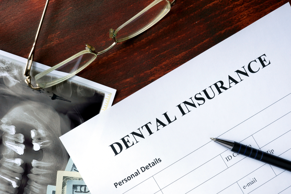 dental insurance documents on a clipboard