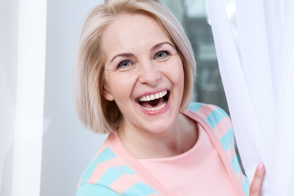 woman with 2 front teeth smiling