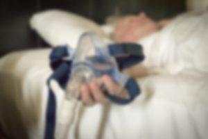 man with breathing machine, blurred photo, man with sleep Apnea or stop breathing while sleeping or sleeping disorder